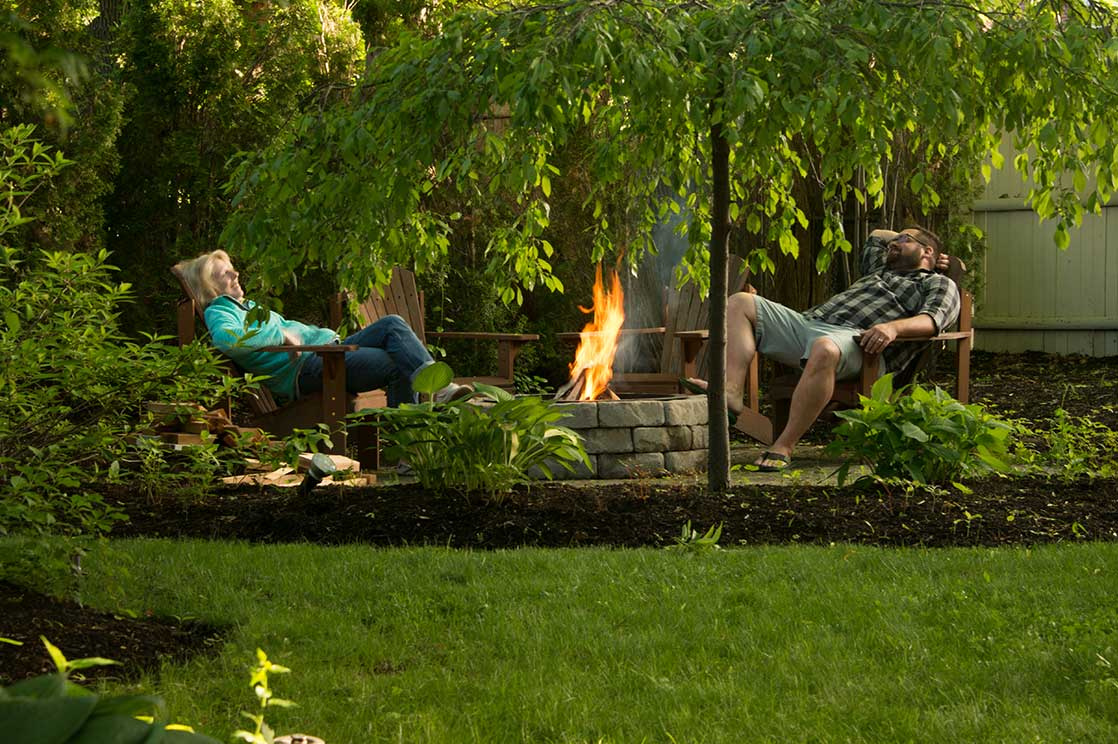 People relaxing at the fire pit