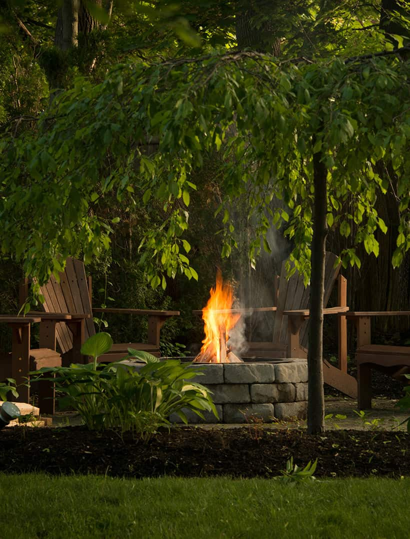 fire pit and chairs in the garden