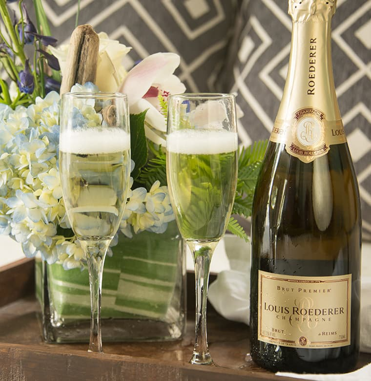 champagne glasses and bottle with flowers