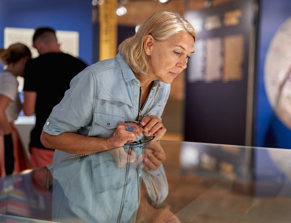 woman looking at exhibit at Maine museum